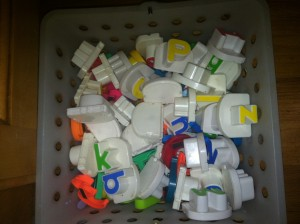 Get all your magnetic letters in a basket or bucket or whatever you have!