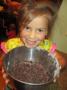 Add in Four cups of semi sweet chocolate cookies.  It is even better if you have a very cute Lucy to help you!