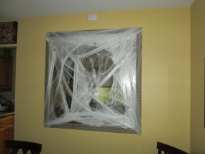 I love the spider webs! You can turn anything spooky!  This is a large mirror, there are a few spiders mixed in the web!