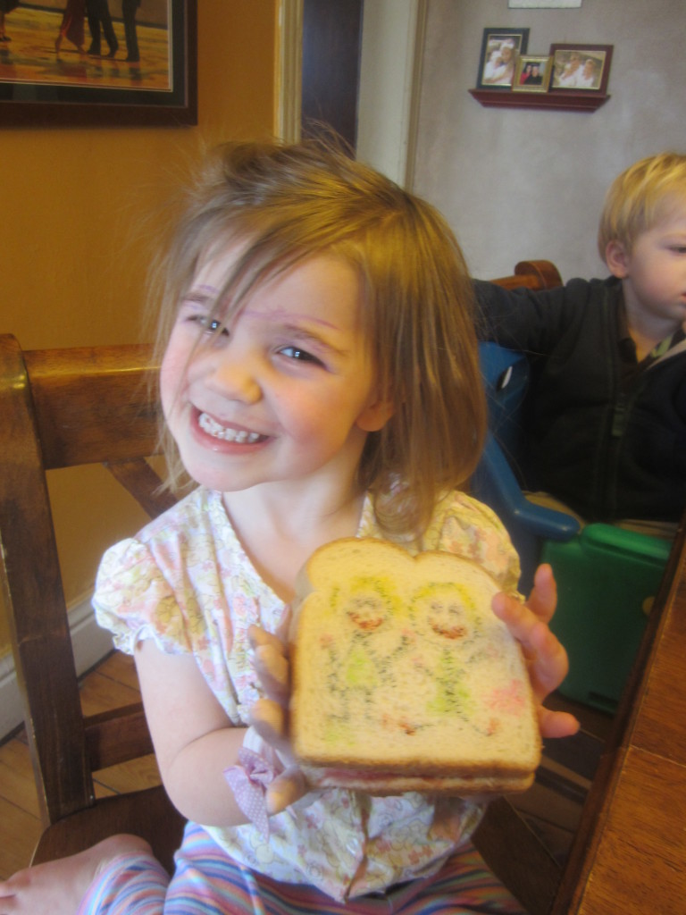 Lucy decorating her sandwich! 2011