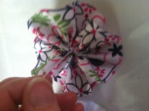 "Arrange the ribbon into a  'flower"" and tie it tight! Make a few knots!"