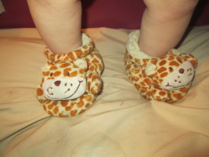 Look at those cute , little, chubby legs and sweet little slippers! I love!