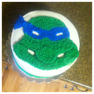 My nephew turned 7!  This was his fun cake, he is supposed to be gritting his teeth, My tucker thought he had four eyes... whaw waw..