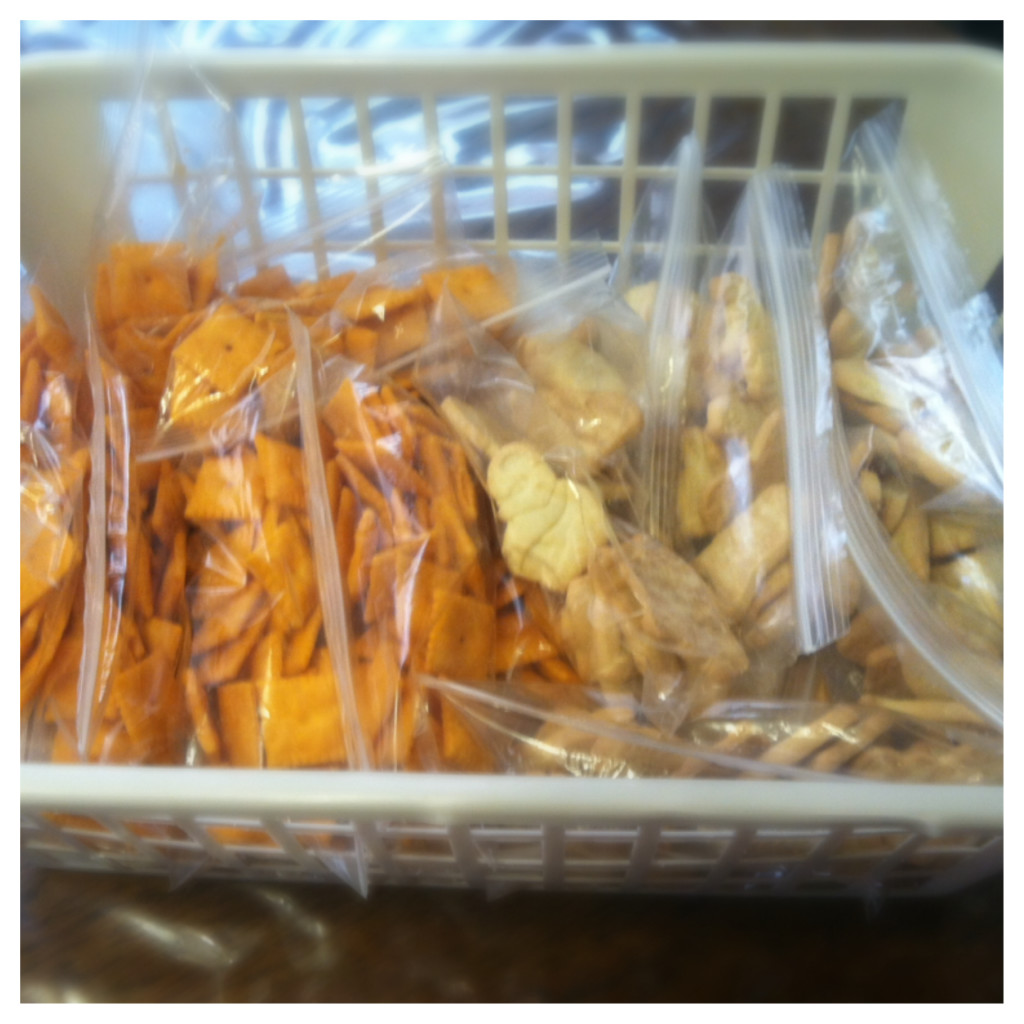I keep all the snacks in a basket in the pantry. Easy to see and easy to grab!  I also have a box for the fridge for snacks like apples and carrots.... but that my friends is next week! So come back and check it out!  Look! about 30 bags of snacks for less than $3.00!!