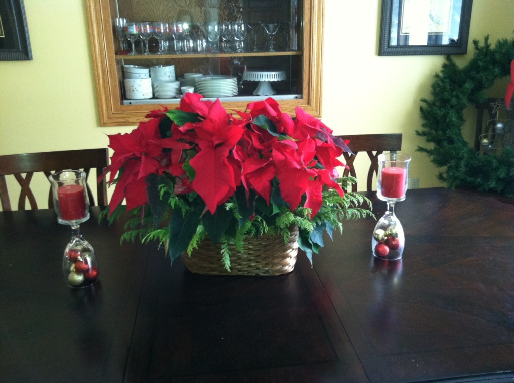 Flip the glasses upside down, put the candle on top, throw a pretty flower in the center and ta duh a pretty centerpiece!