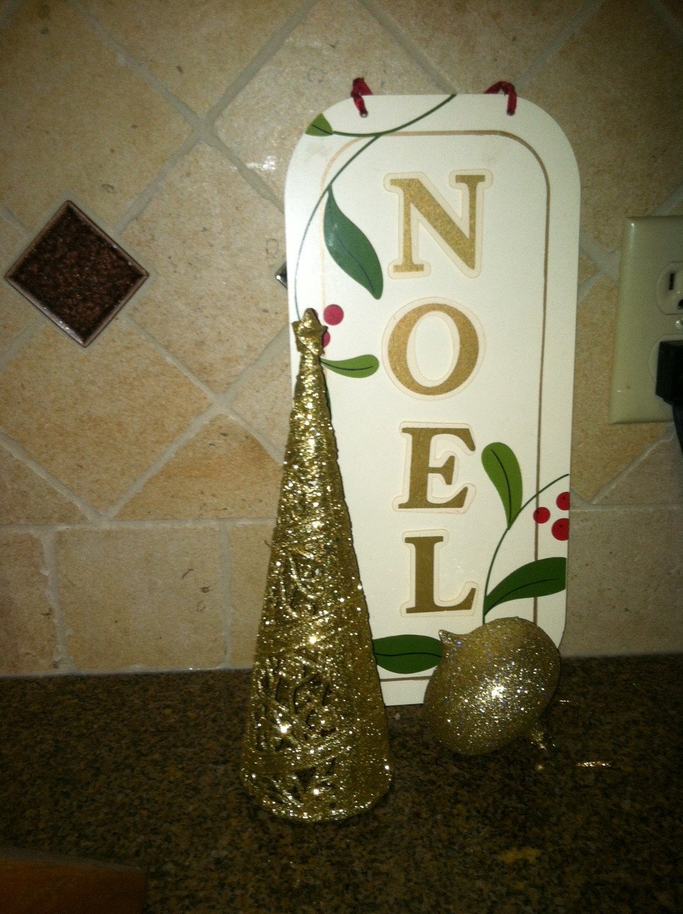 This one is great, I think things look good in threes.  The tree and the sign are from the dollar store, the ornament is one from my mom, Thanks mom!  This is on the counter in the kitchen!