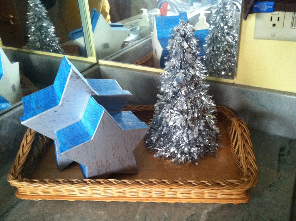 Super simple, grab a few holiday shaped nesting boxes and  a simple silver tree!  This is in our upstairs bath.  Total cost $3.00