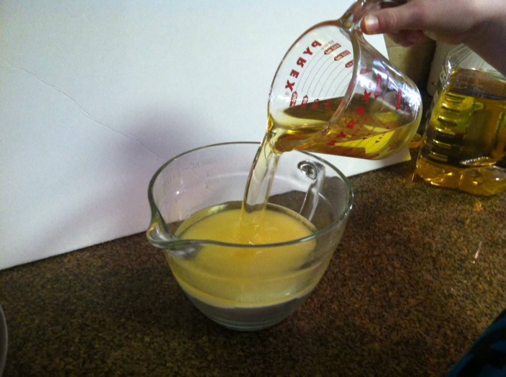 Pour 2 cups of olive oil into 4 cups of sugar.