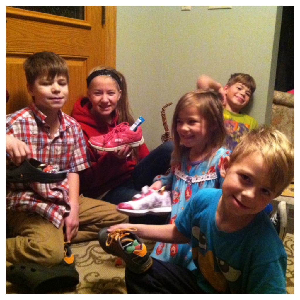 St. Nick came!!  He has just started coming to our house!  This is the second year, he always puts a little candy in the childrens shoes!  Look how rough they all look!  This was a 6 am this morning!  I love it!