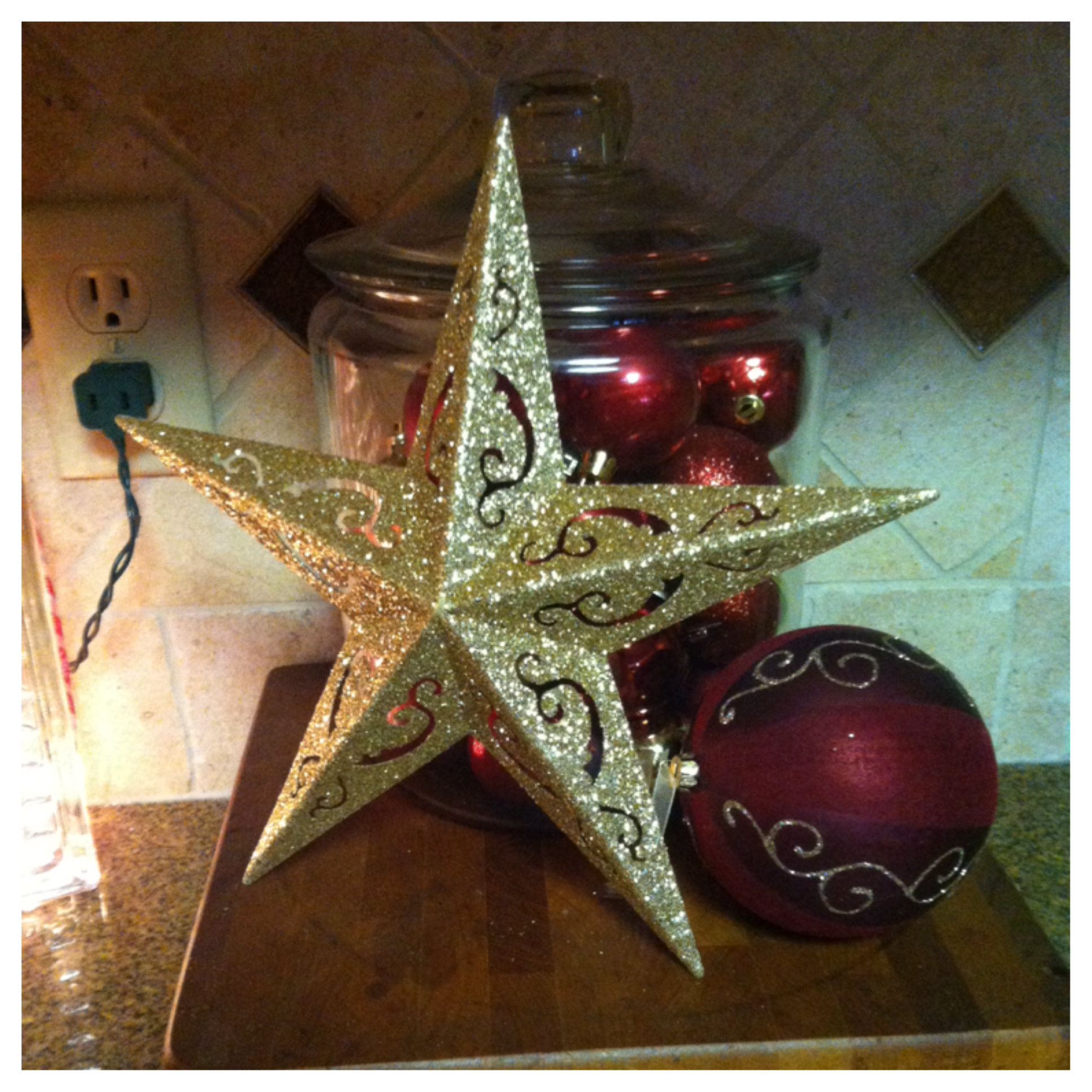 DOLLAR STORE DECORATIONS!!   The ornaments, the star and the big ornament ball are all from the dollar store! Well, everything but the jar.This little set up is in the kitchen.  I LOVE IT!