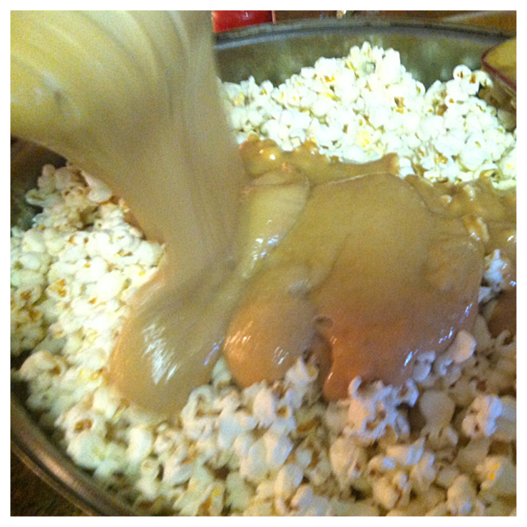 Pour over popcorn, fold into popcorn until all mixed.