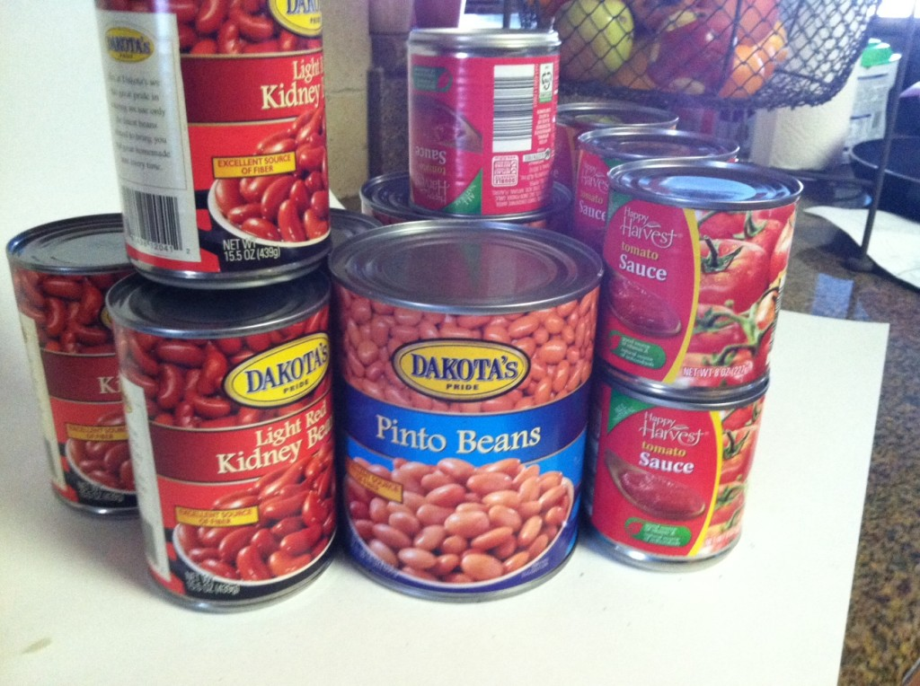 You will need kidney beans, pinto beans and tomato sauce.  30 oz of each, or right around there.  Basicallly, one big can, or two med cans or 4 of the little cans.