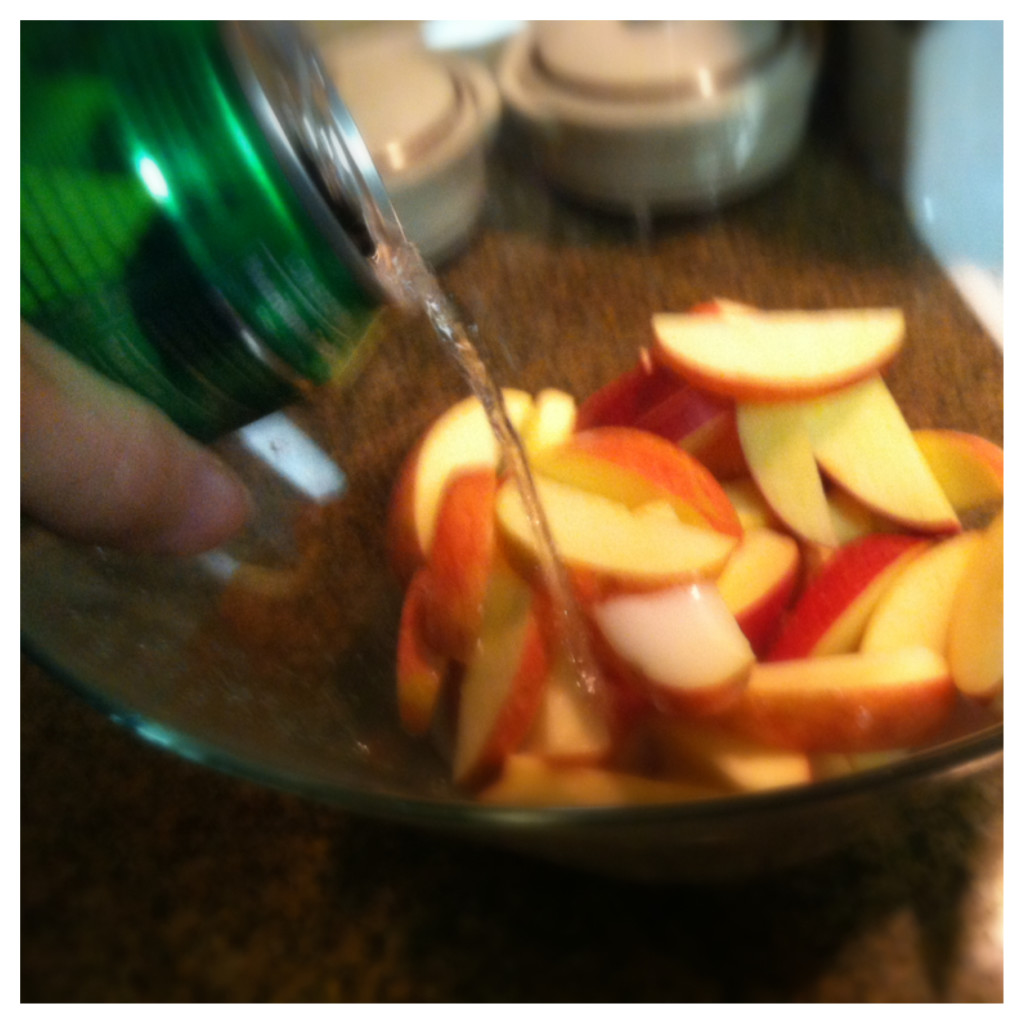 Put your apples in a bowl and cover them with the soda pop.